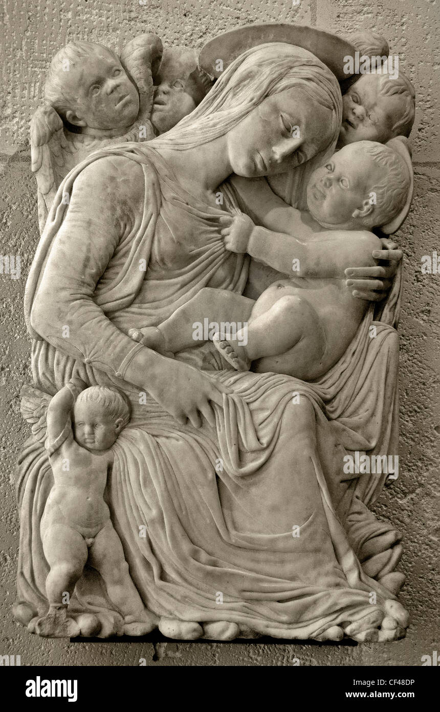Virgin Mary Child Jesus Christ surrounded with angels influence influenced by Donatello 15 Century Italy Italian - Stock Image