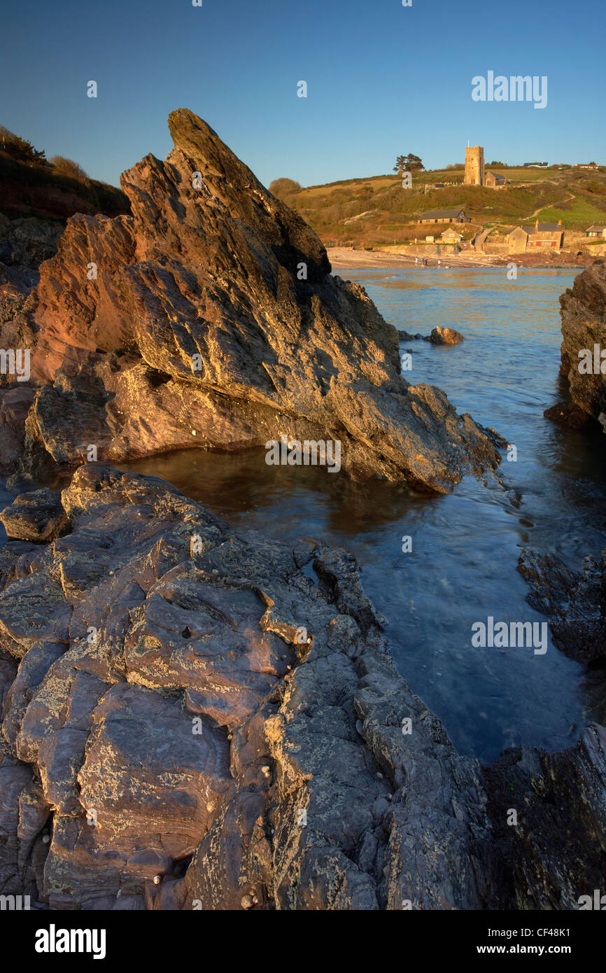 Wembury Bay church in late evening light during early Summer. - Stock Image
