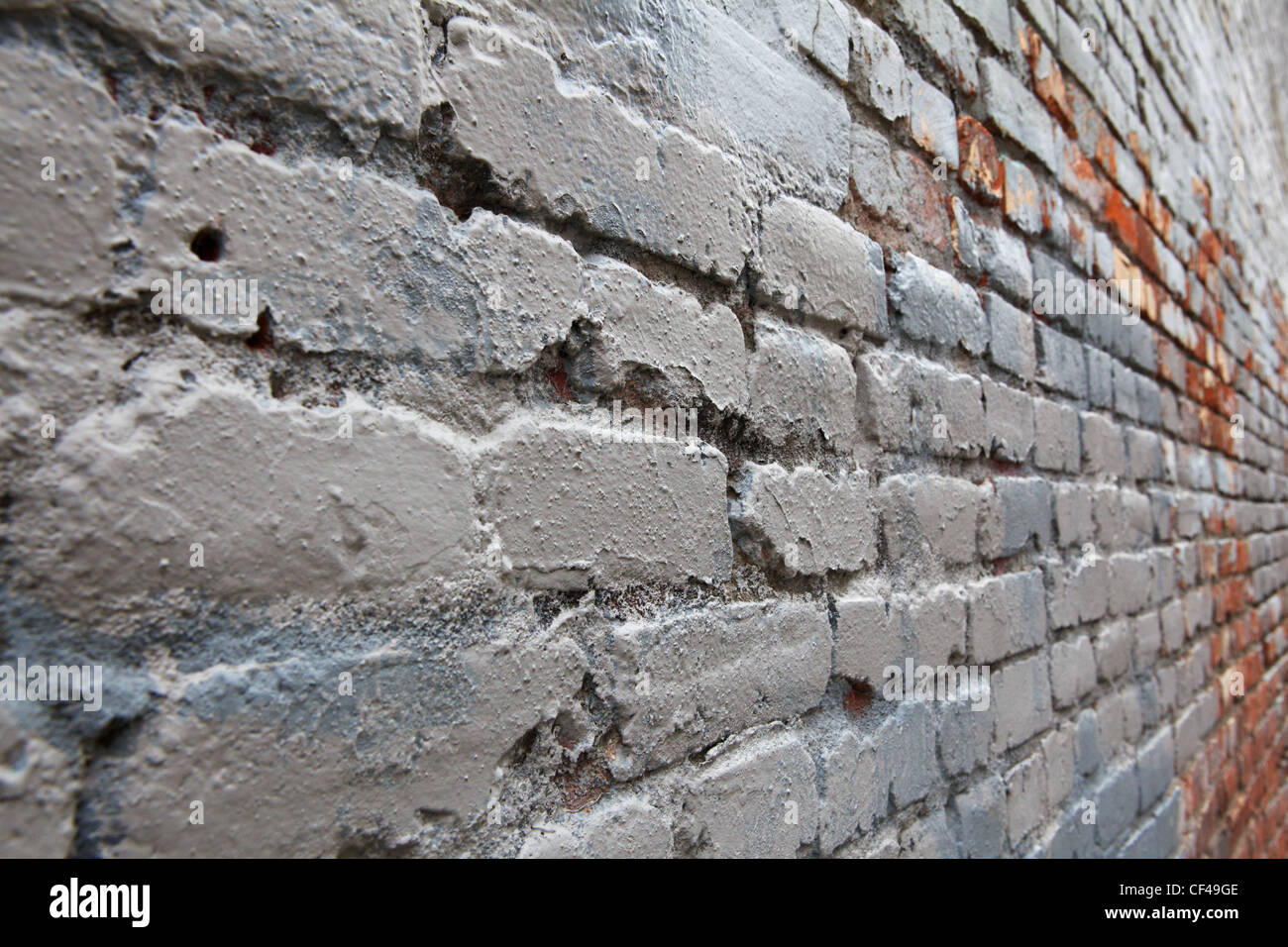 Weathered and worn Gray Brick in Perspective diminishing to the right - Stock Image