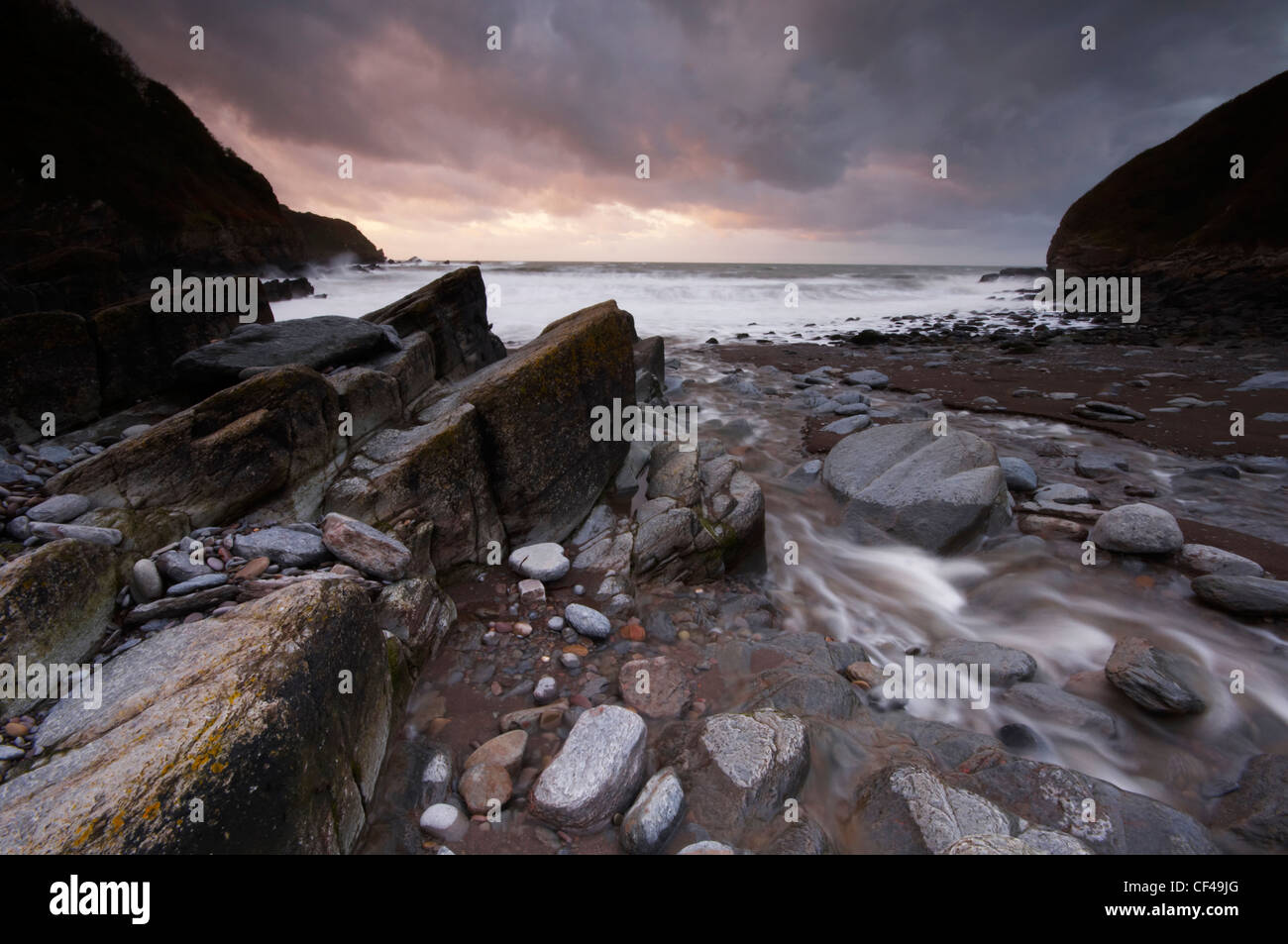 A stormy dusk at Lee Bay on the North Devon coast. - Stock Image