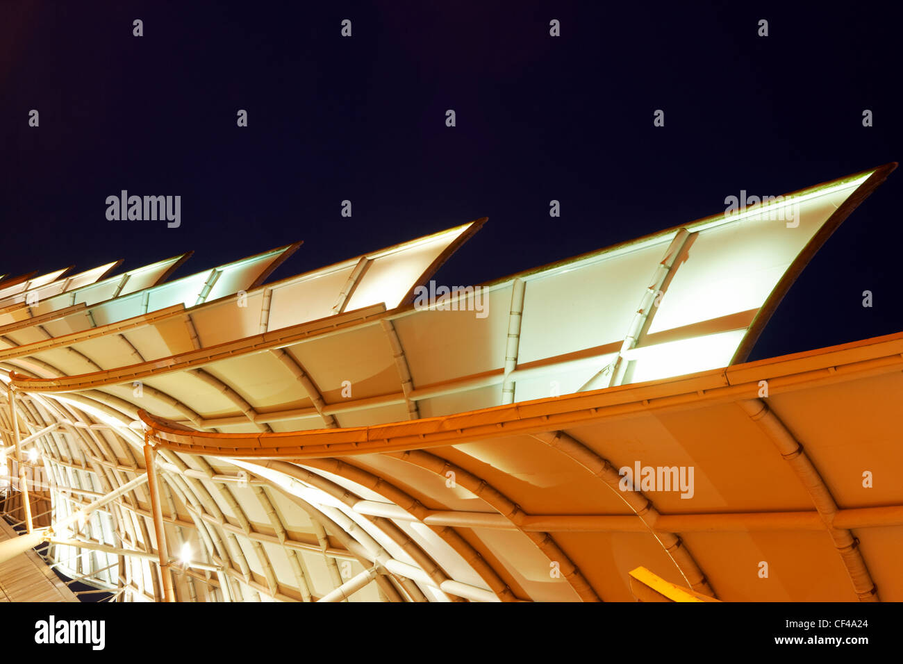 The Sainsburys sails, a functional building which forces wind up over the A38 road in Plymouth. - Stock Image