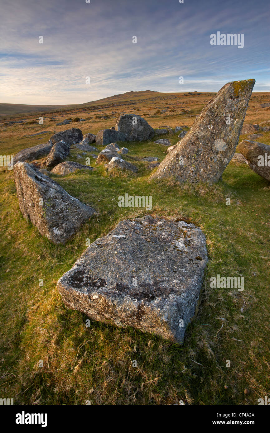 Remnants of a stone hut circle at Merrivale settlement on Dartmoor. - Stock Image