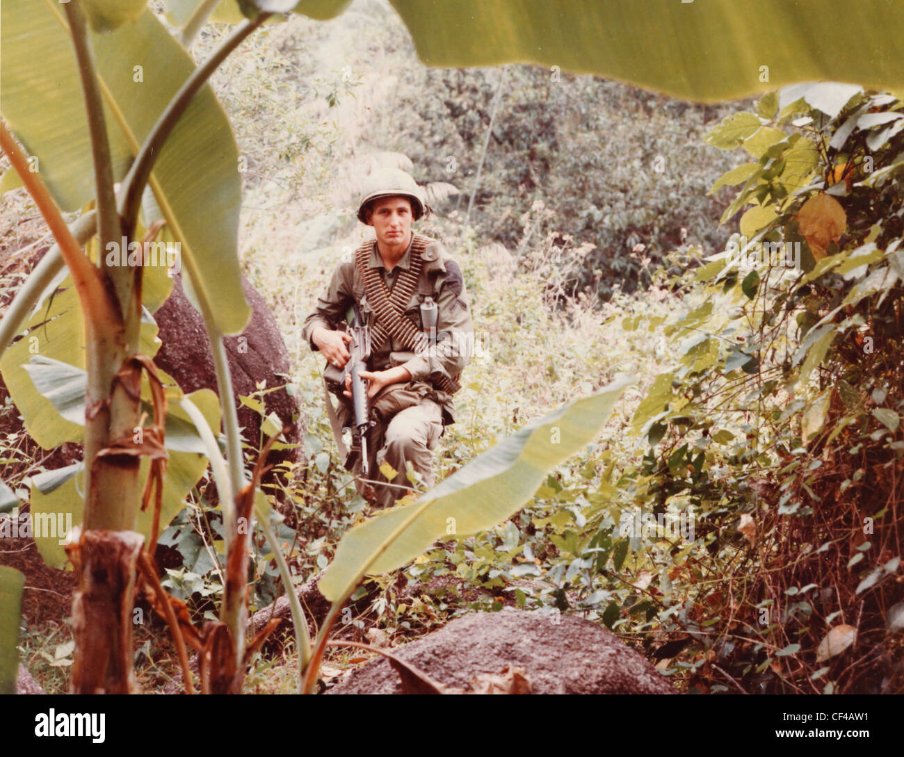 ammunition bearer 1st Cav Division Airbmoble moves along a mountain trail during operation pershing search and destroy - Stock Image