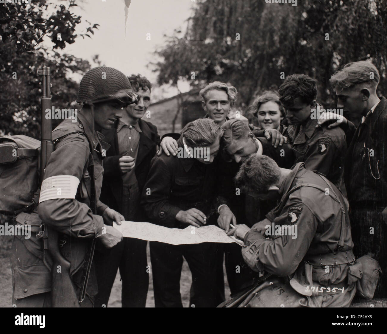 Dutch civilians show members of the 101st Airborne Division who landed behind German lines in Holland the lay of - Stock Image