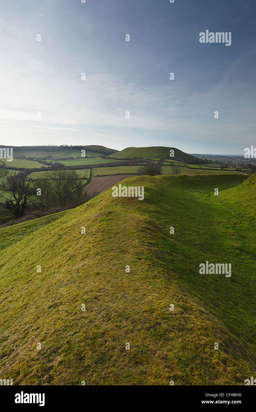 Ramparts on Cadbury Castle hill fort looking towards Parrock Hill. Somerset. England. UK. - Stock Image