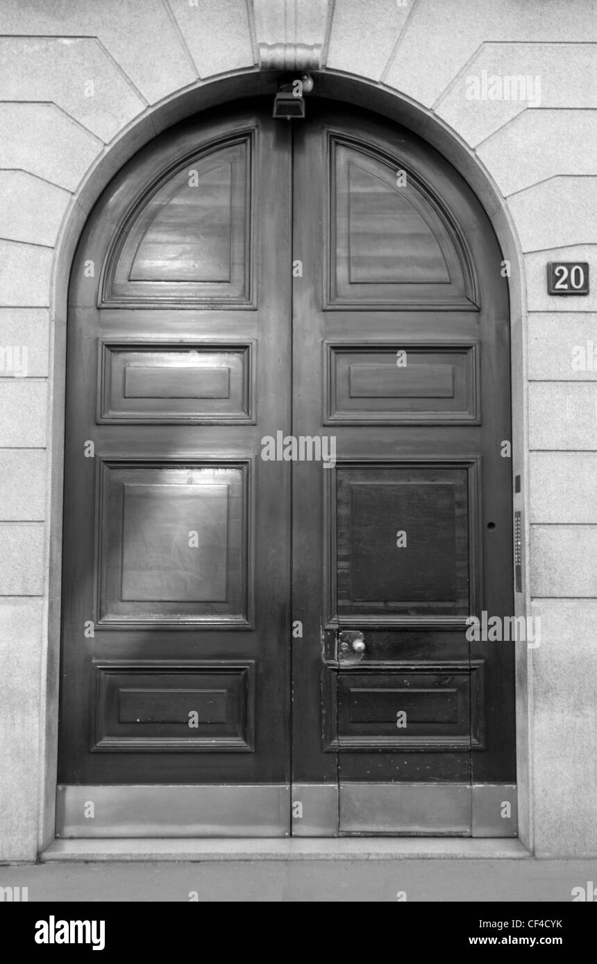 An old main door in Milan - Stock Image