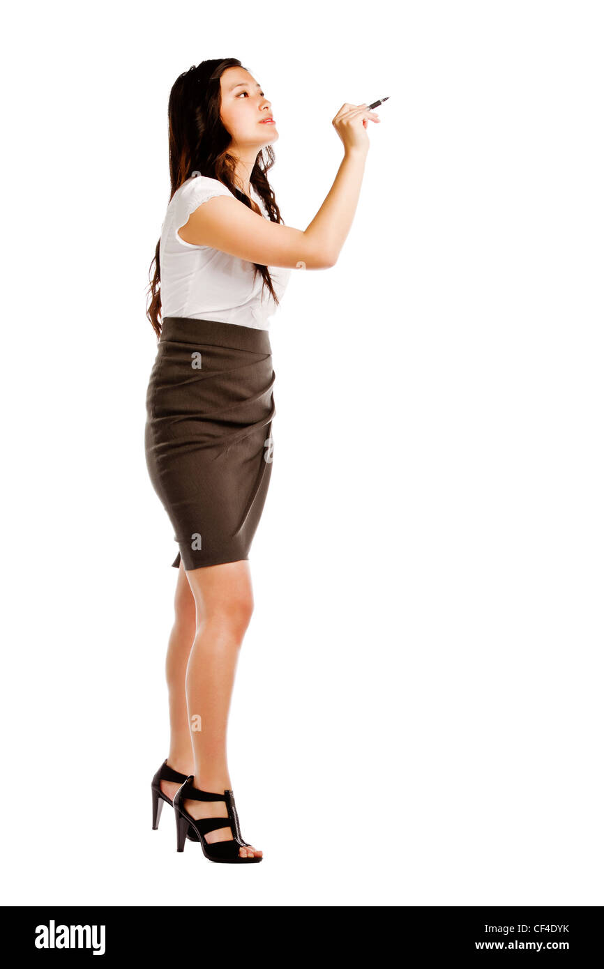 Attractive young asian business woman writing something against white background - Stock Image