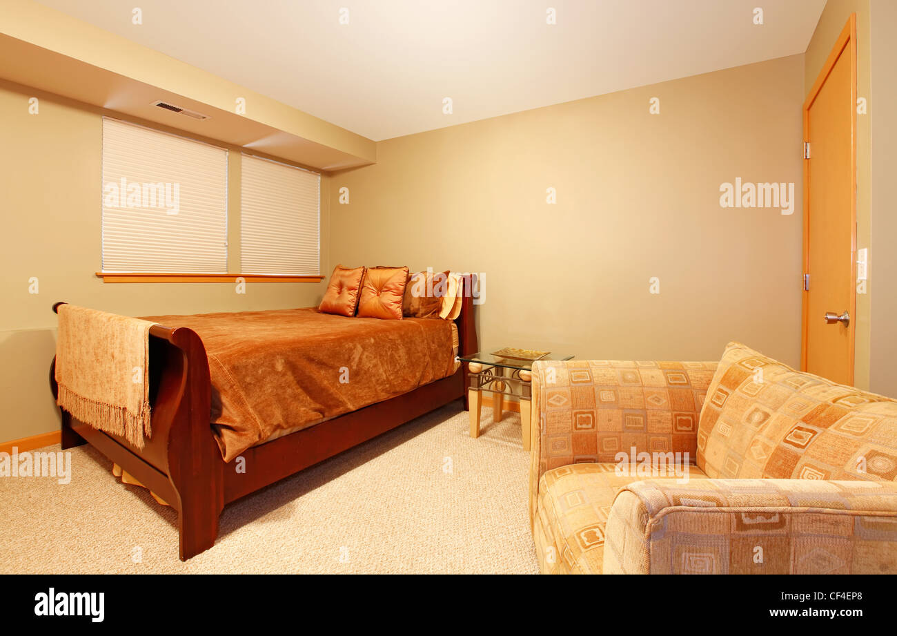 Garden level simple guest bedroom with one single bed and ...