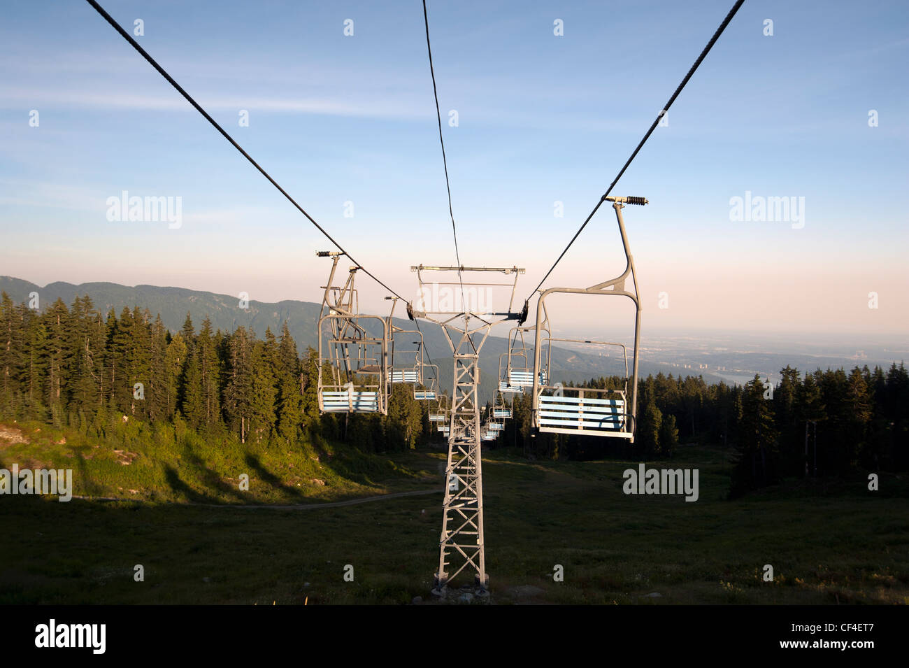 Empty chairlifts at Grouse Mountain Ski Resort in summer Stock Photo