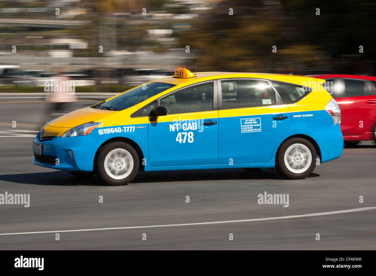San Diego city taxicab chauffering customer to the airport -San Diego, California, USA. - Stock Image