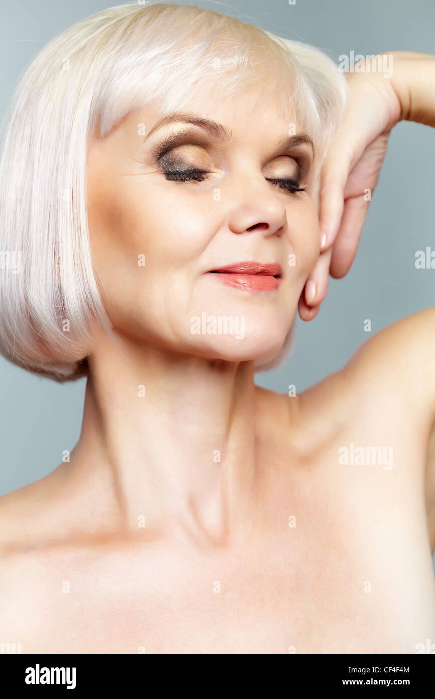 Mature woman nude portrait Portrait Of A Nude Mature Lady With Her Eyes Closed And Hand Gracefully Held Stock Photo Alamy