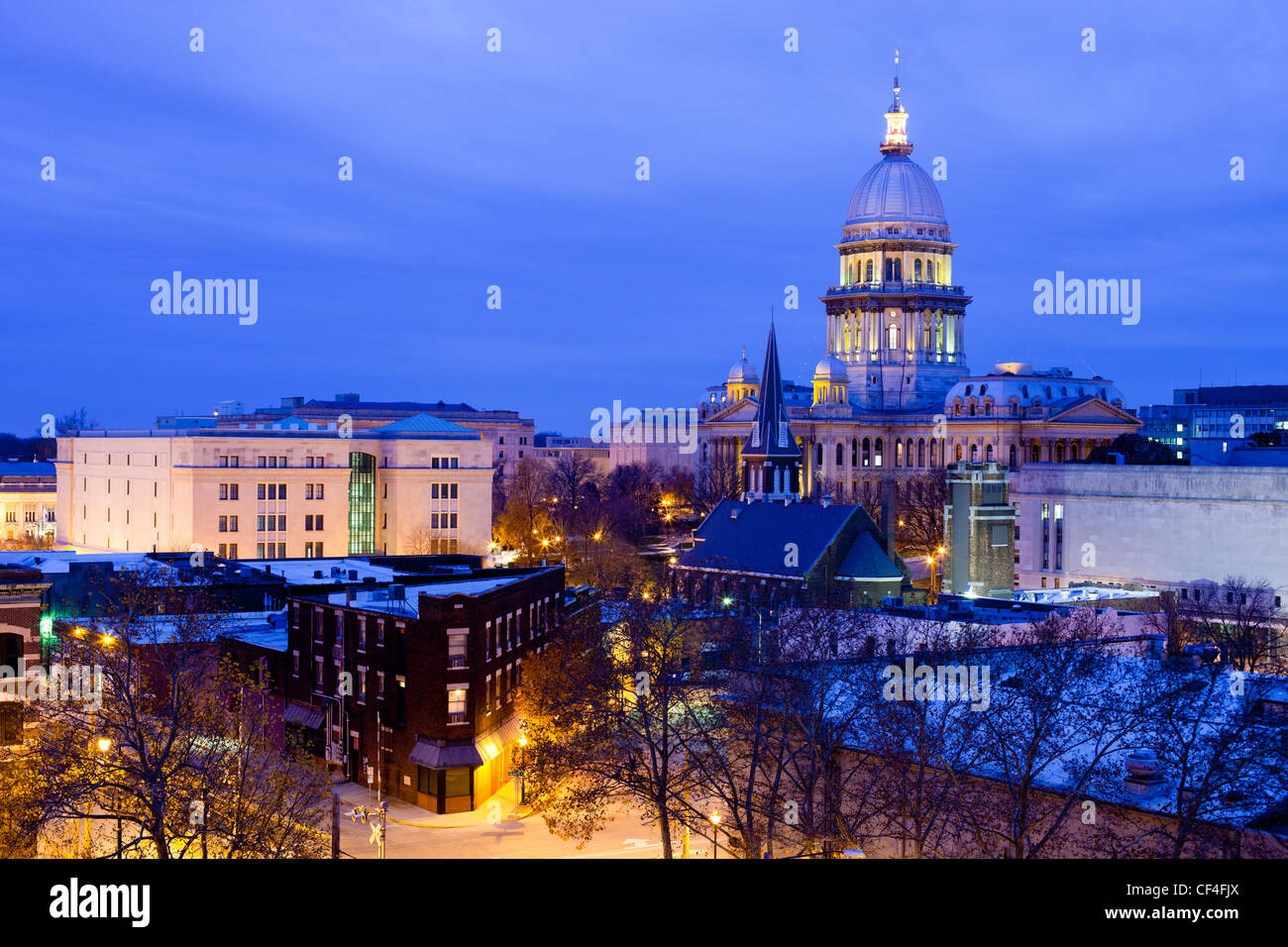 The Illinois State capital building looms over downtown Springfield, IL on a cold winter evening. - Stock Image