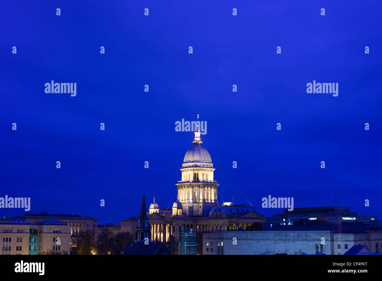 The Illinois State Capital building dome is lit up against a twilight blue sky in Springfield, IL. - Stock Image