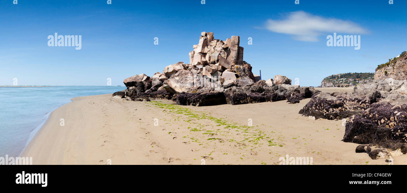 The demolished Shag Rock, a well-known landmark on the beach in the Christchurch suburb of Sumner - Stock Image