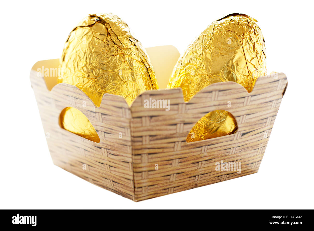 Two gold foil chocolate Easer Eggs in a cardboard punnet - Stock Image