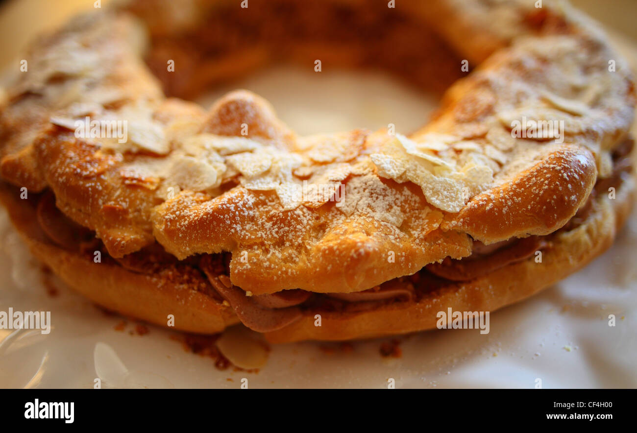 Paris Brest ring cream cake desert on a plate - Stock Image