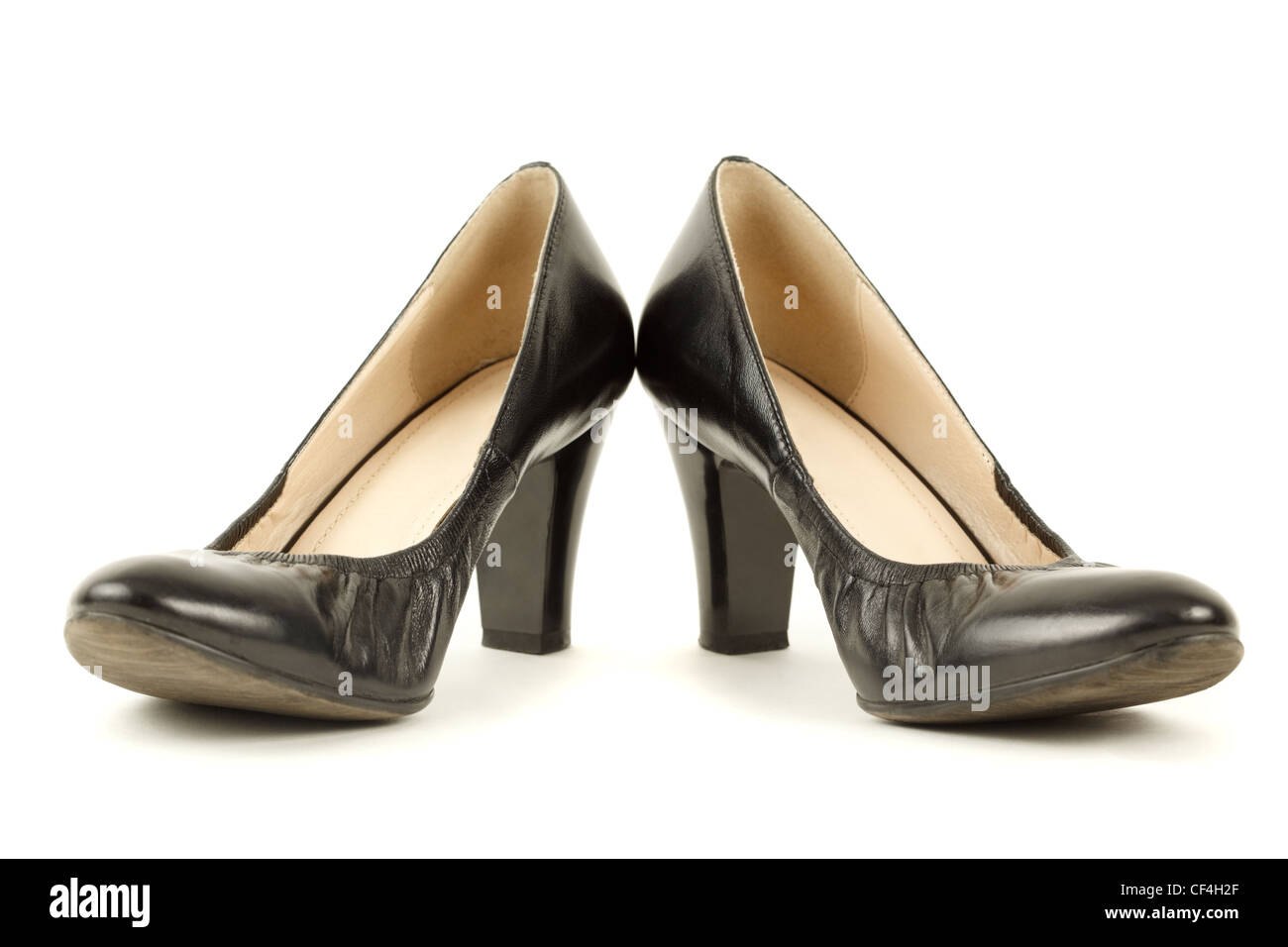 Pair of black women's high heels. Isolated on white background. - Stock Image