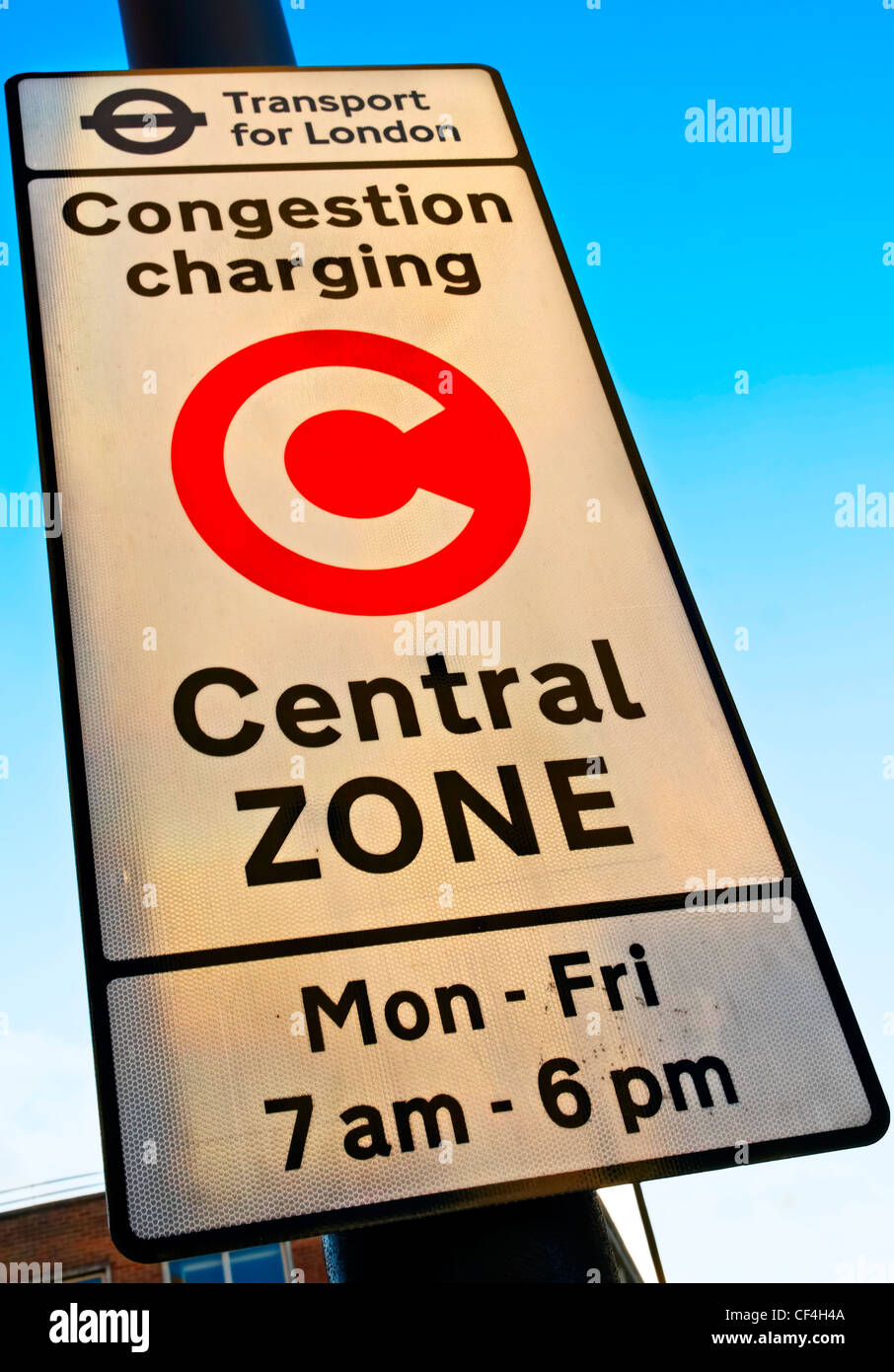 London Congestion Charge sign indicating the point and times at which a fee is charged to motorists travelling in - Stock Image