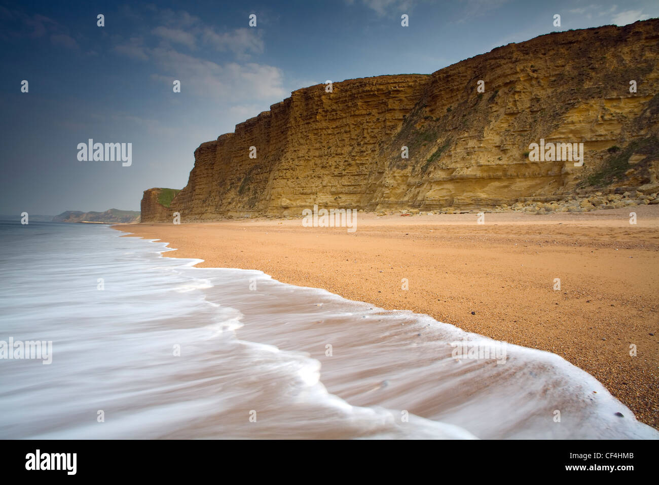 A view toward Burton Cliff. The Jurassic Coast consists of Triassic, Jurassic and Cretaceous cliffs, spanning the - Stock Image