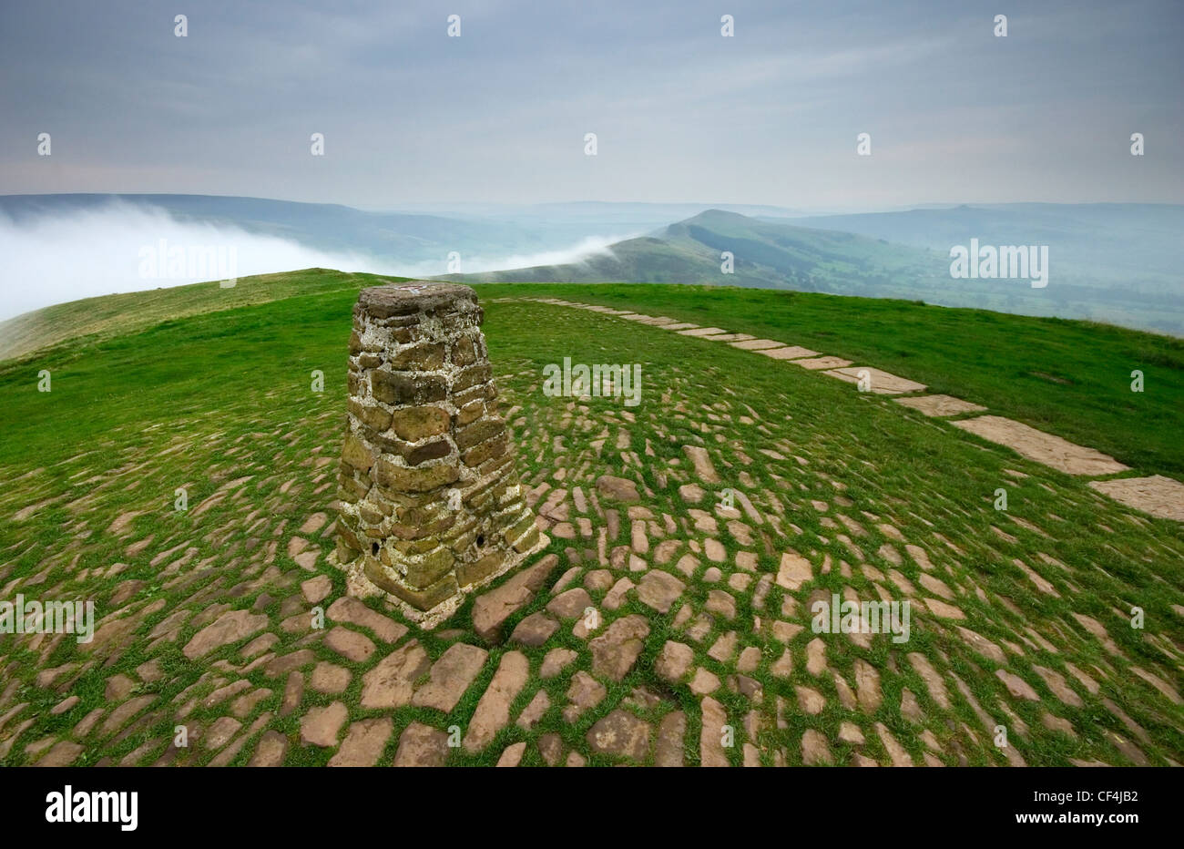 A misty morning at the Mam Tor trig point in Derbyshire. - Stock Image