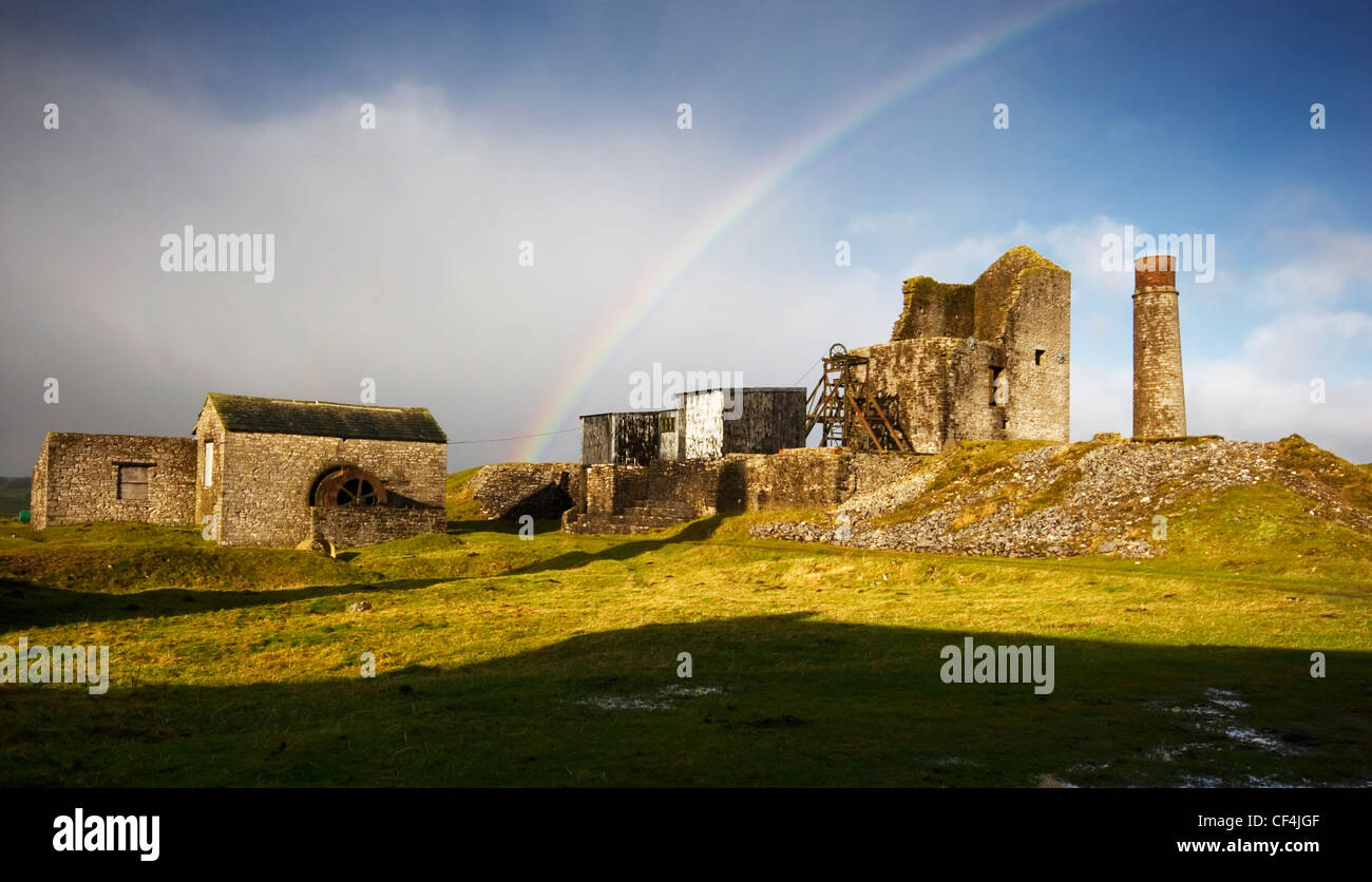 A rainbow appears over the disused  Magpie lead mine in Sheldon. - Stock Image