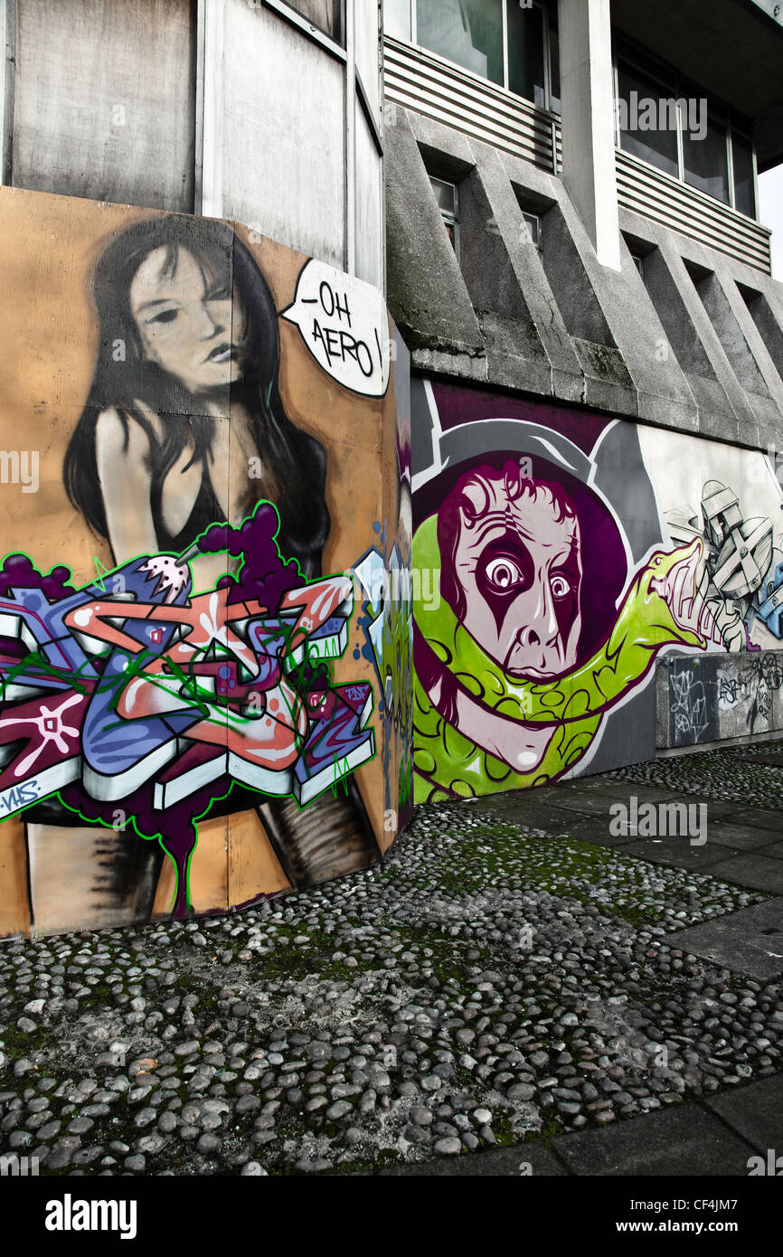 Colourful graffiti on the walls of a neglected part of the city. - Stock Image