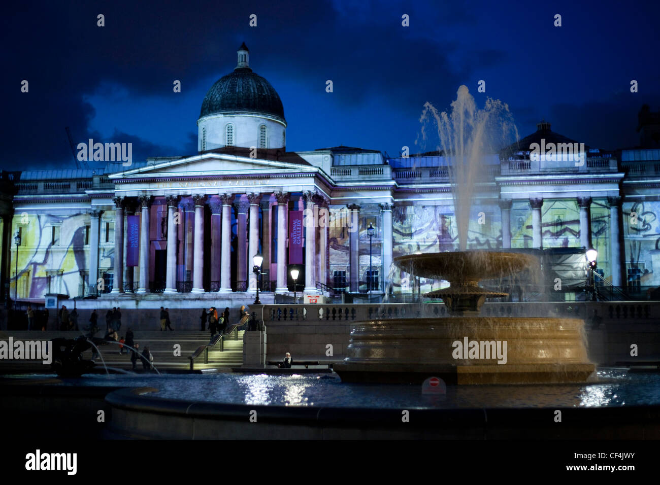 The National Gallery lit by the projected images of Picasso. - Stock Image