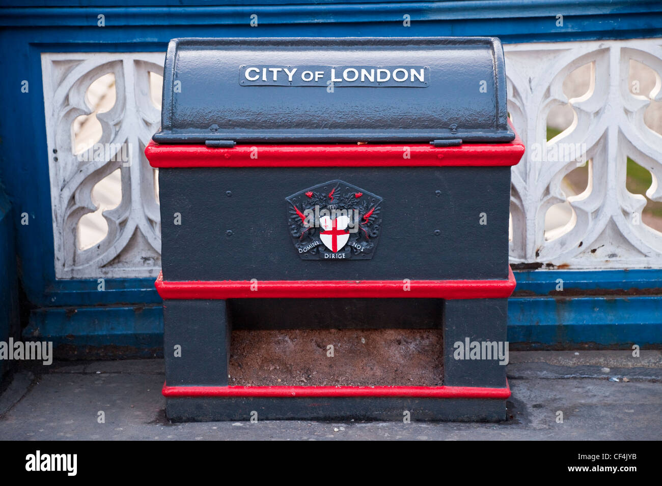 An old metal box containing grit for spreading on the roads when icy in London. - Stock Image