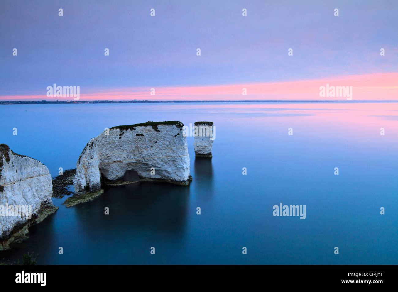 Old Harry Rocks, two chalk sea stacks located at Handfast Point, on the Isle of Purbeck at sunrise. - Stock Image