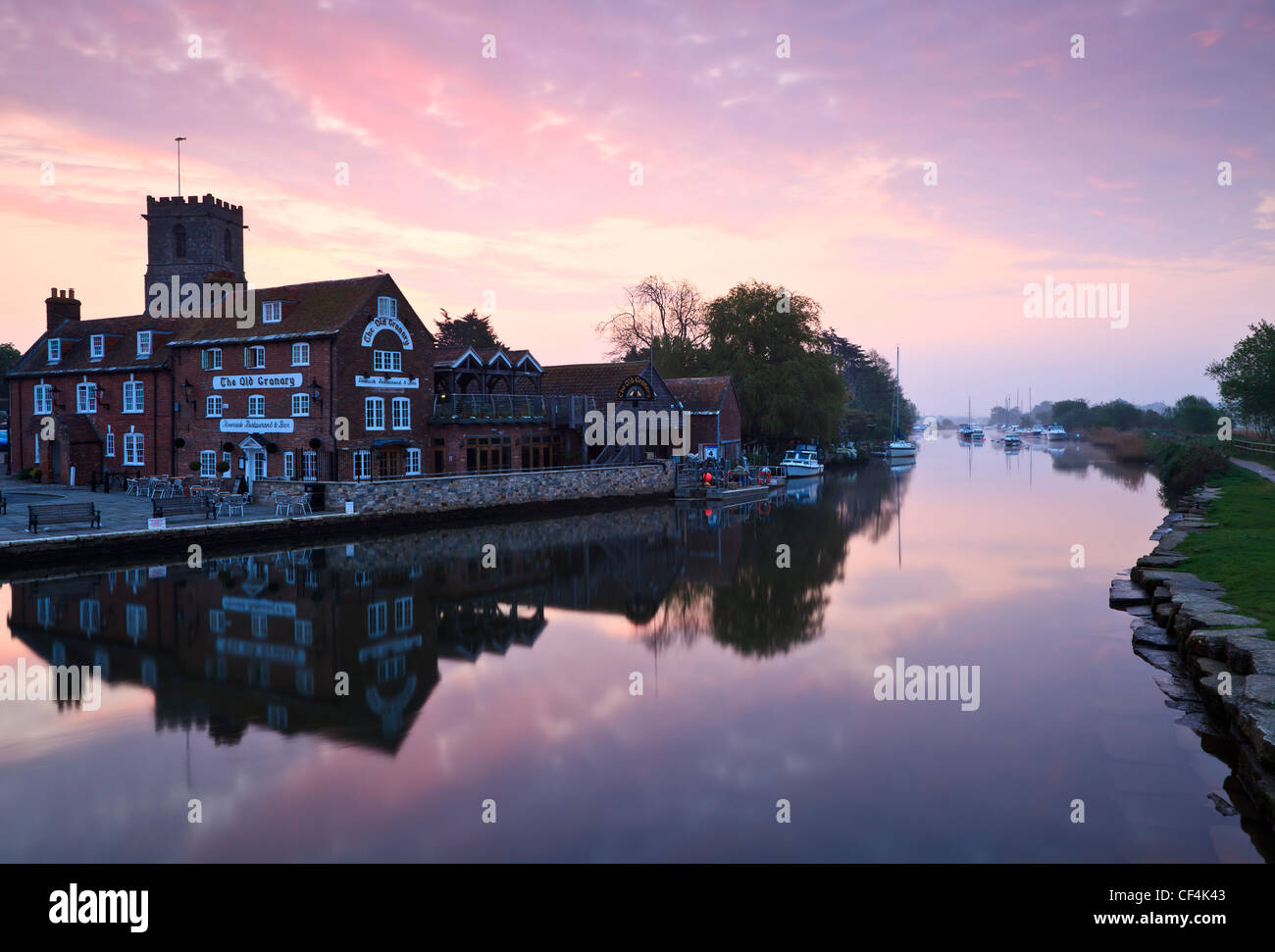 Dawn over The Old Granary, Riverside Restaurant and Bar by the River Frome at Wareham Quay. - Stock Image