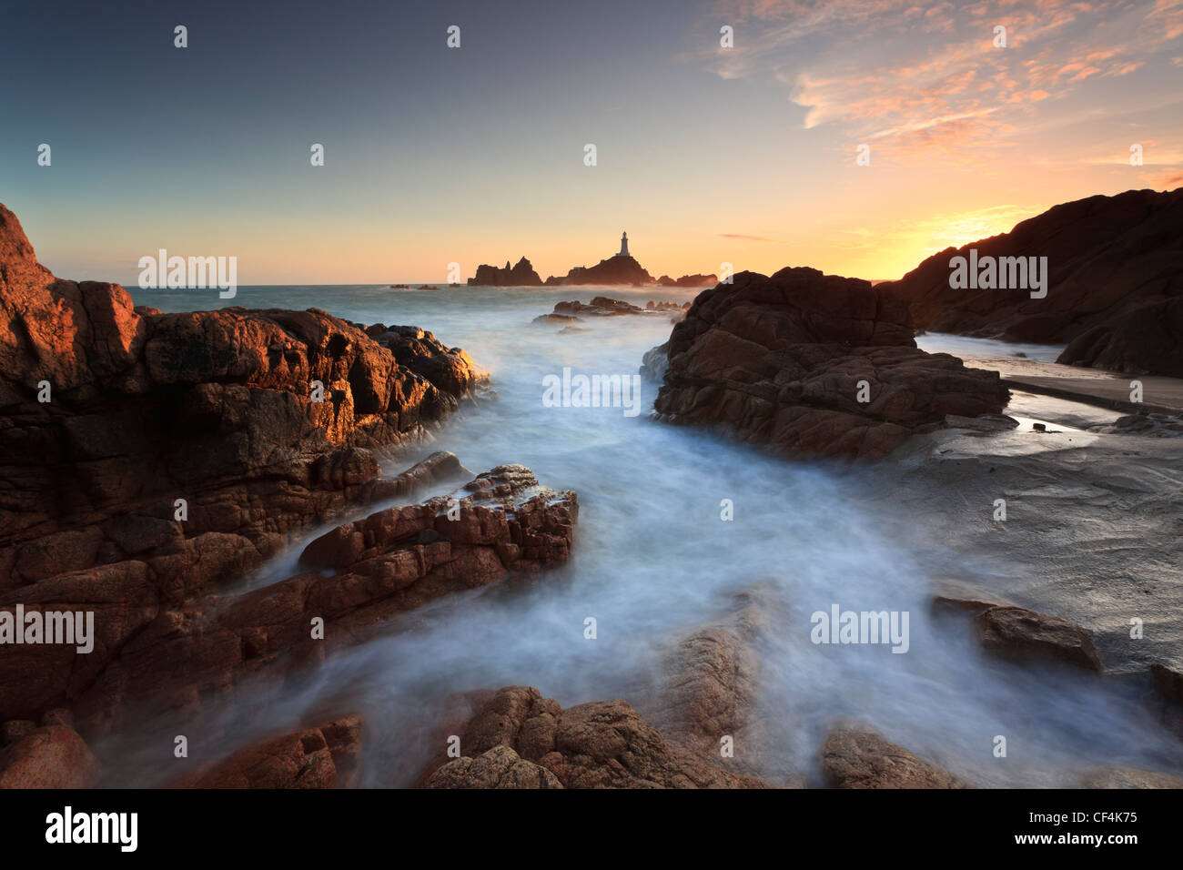 La Corbiere Lighthouse, the first in the British Isles to be built from concrete, at sunset. - Stock Image
