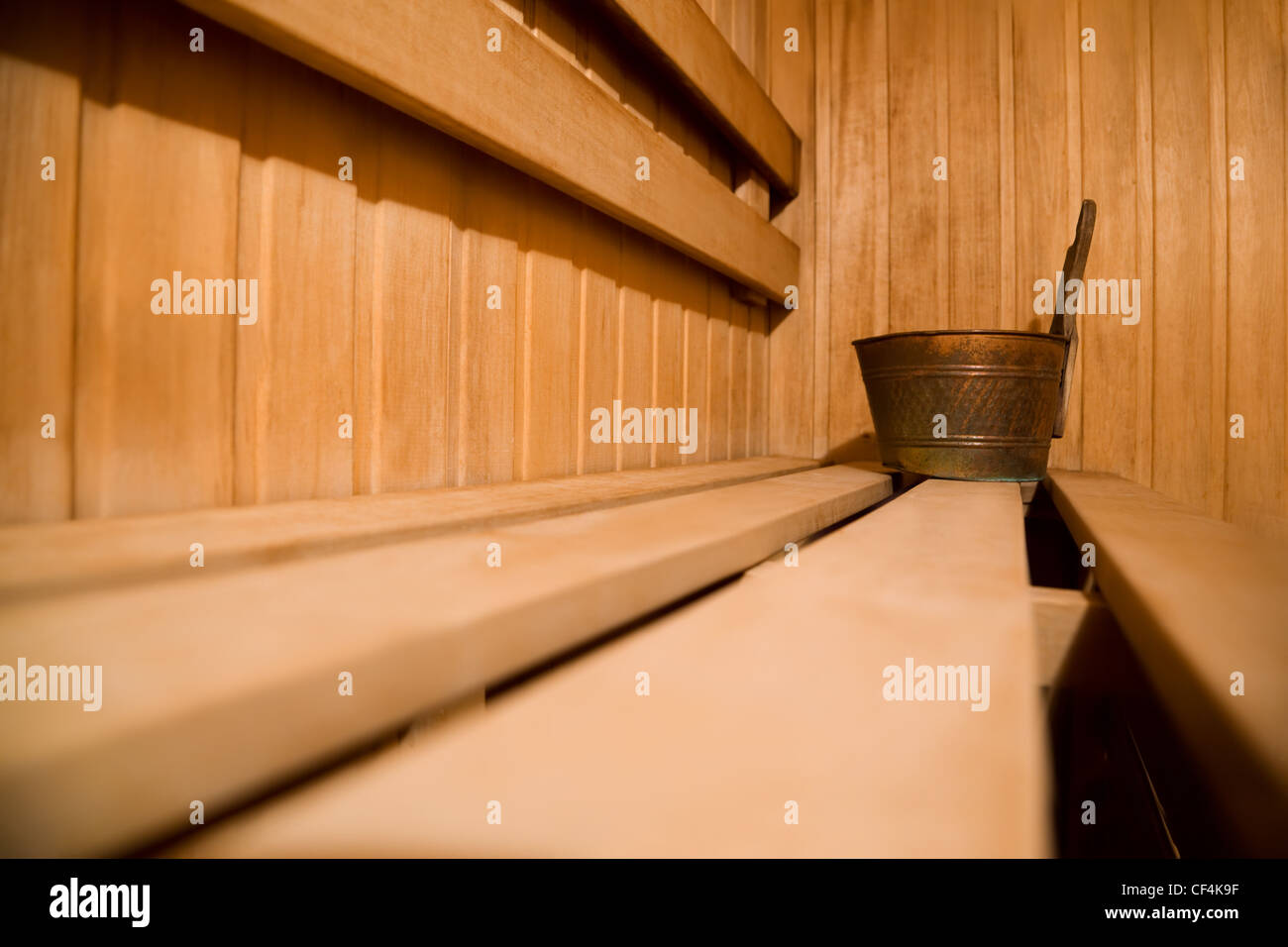 Bench in sauna and copper bucket - Stock Image