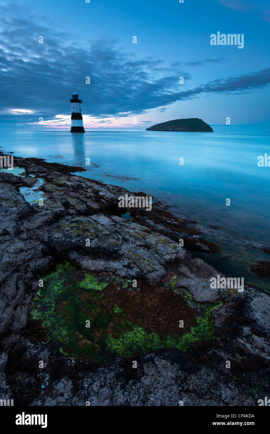 Penmon lighthouse and Puffin Island at Penmon Point on the Isle of Anglesey. Stock Photo