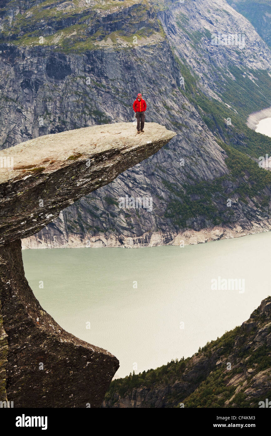 hike in Norway mountains,Trolltunga cliff near Odda - Stock Image