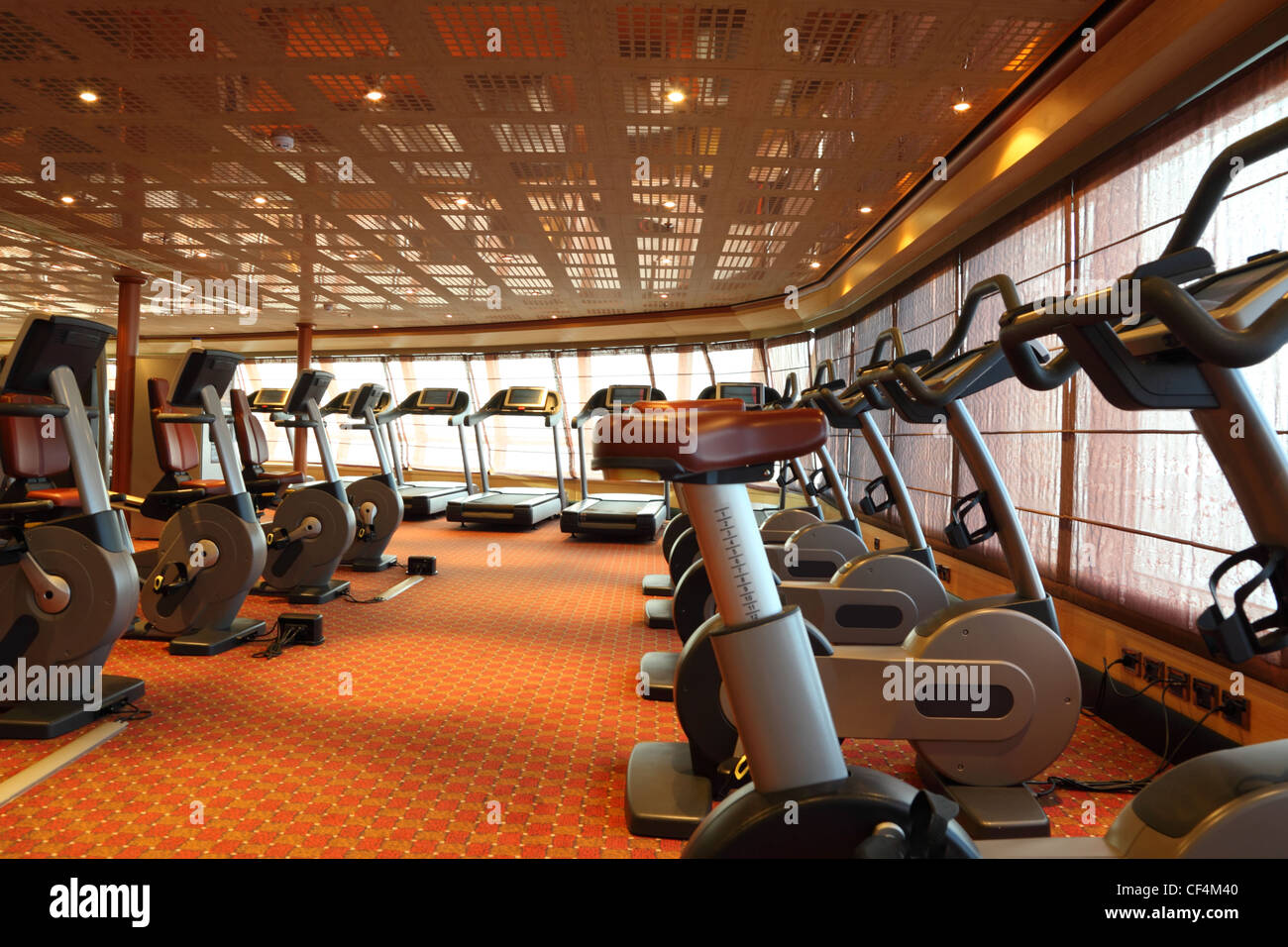 large gym hall with treadmills and exercise bicycle in cruise ship - Stock Image