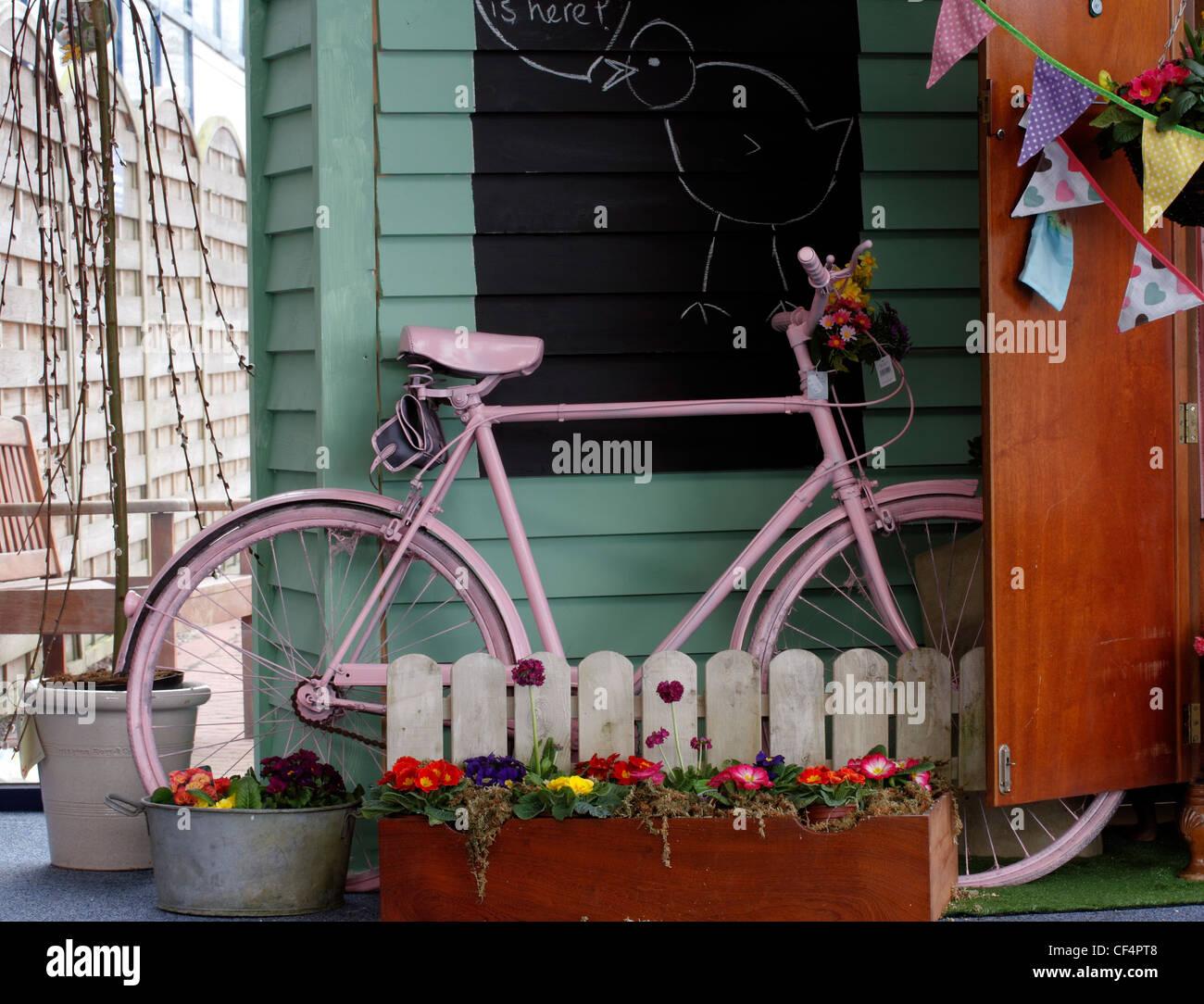 Pink bicycle - Stock Image