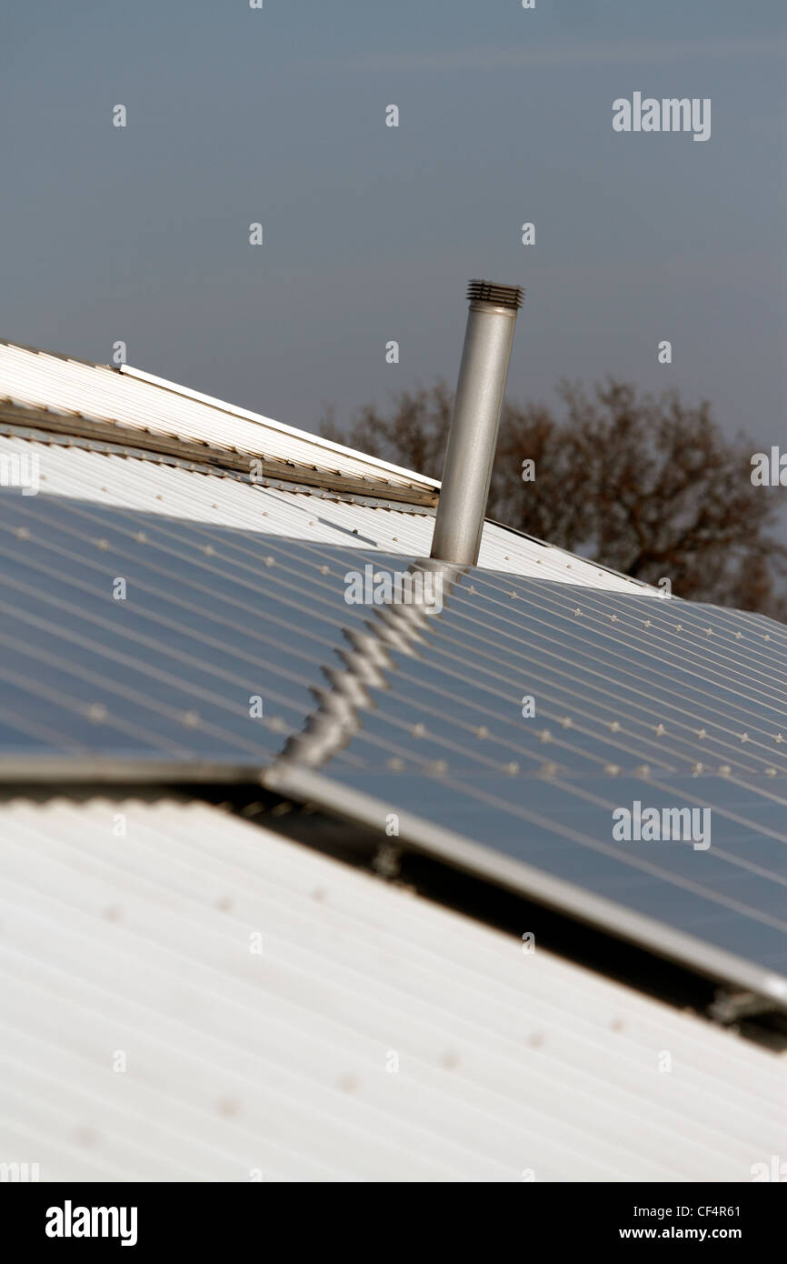 40 solar panels on a garden Centre roof - providing 10 kilowatts of energy Stock Photo