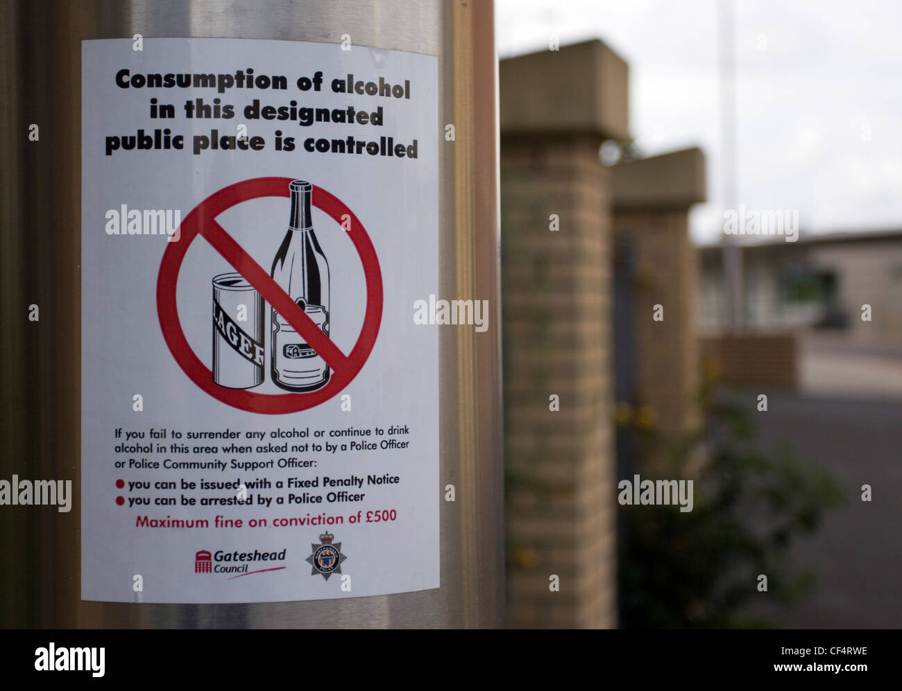 Sign warning that consumption of alcohol in the area is controlled. - Stock Image
