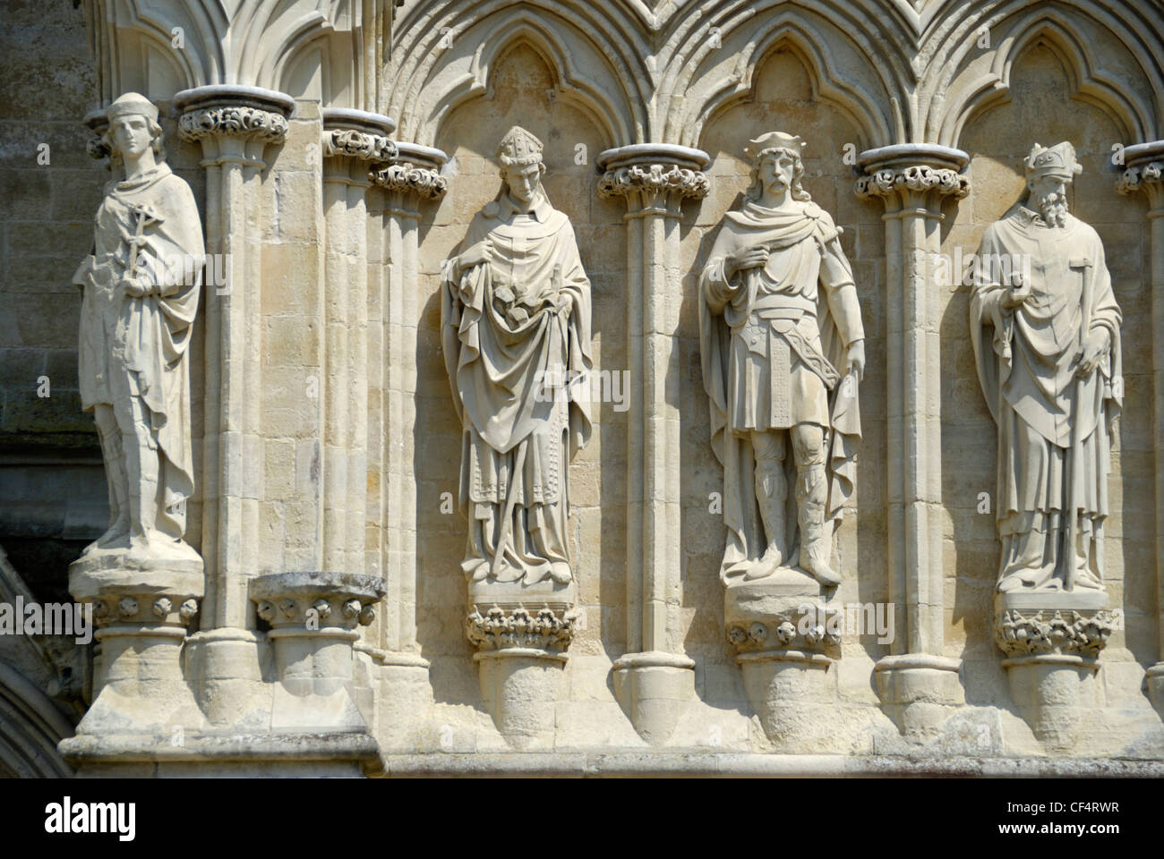 Statues of Saints and allegorical figures on the exterior of Salisbury Cathedral. - Stock Image