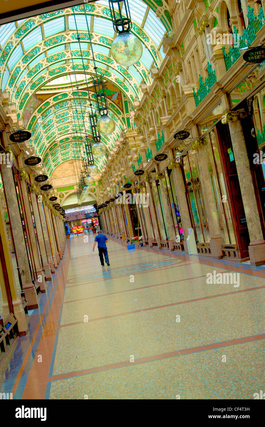 A man walking through County Arcade in the Victoria Quarter of Leeds. The Victoria Quarter was built around 1900 - Stock Image