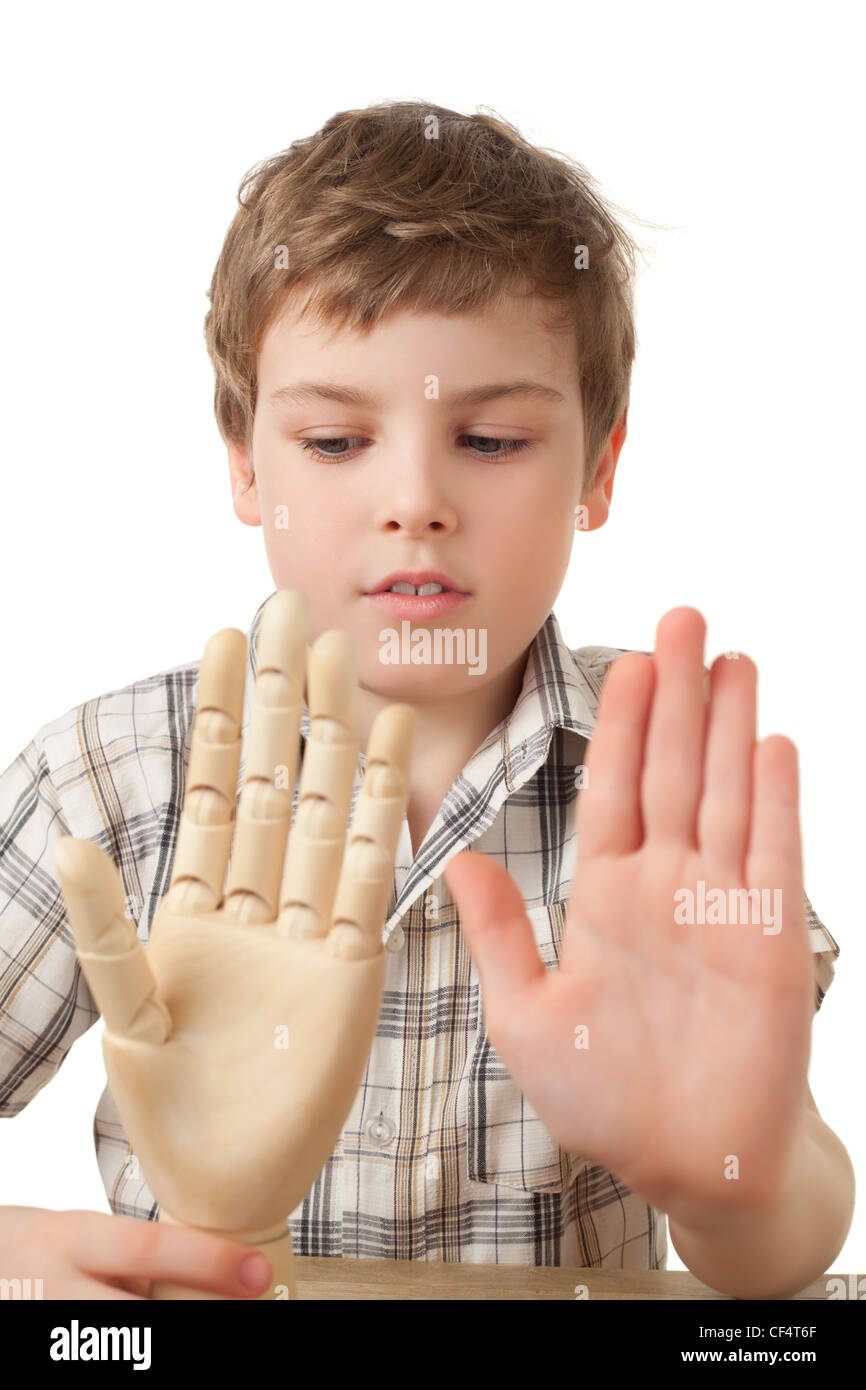 boy is played by wooden hand of manikin isolated on white background, Two palms - Stock Image