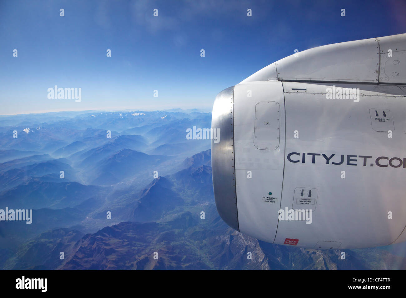 Jet engine on cityjet passenger aircraft over the italian alps, Northern Italy, Europe - Stock Image