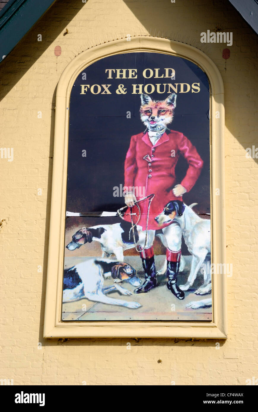 A pub sign on a wall outside The Old Fox and Hounds pub in Croydon. Stock Photo
