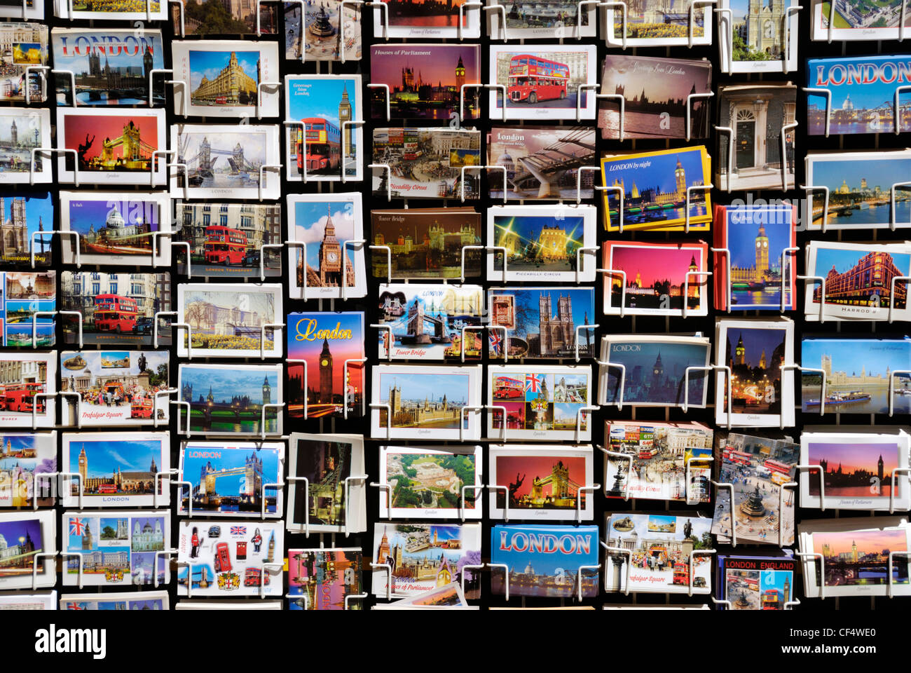 Picture postcards for sale on a stand in London. - Stock Image