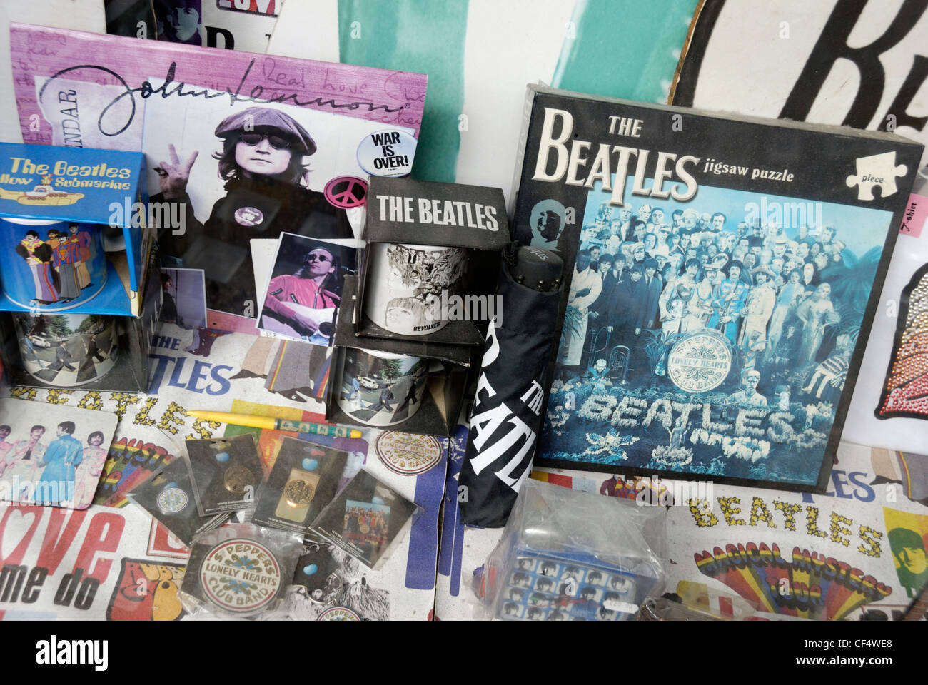 A close up of Beatles memorabilia in a shop window in Baker Street. - Stock Image