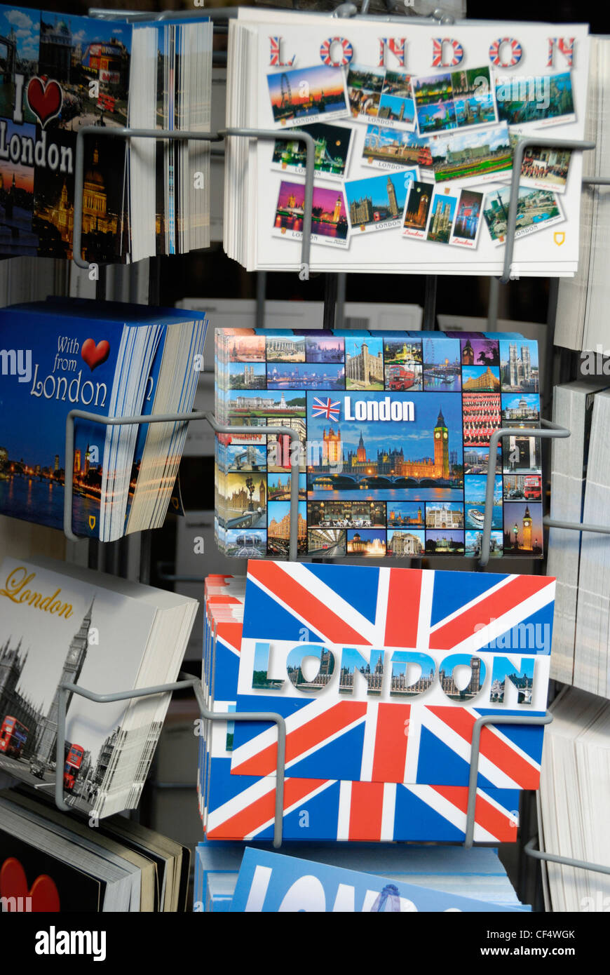 London postcards for sale in a stand outside a souvenir shop. - Stock Image