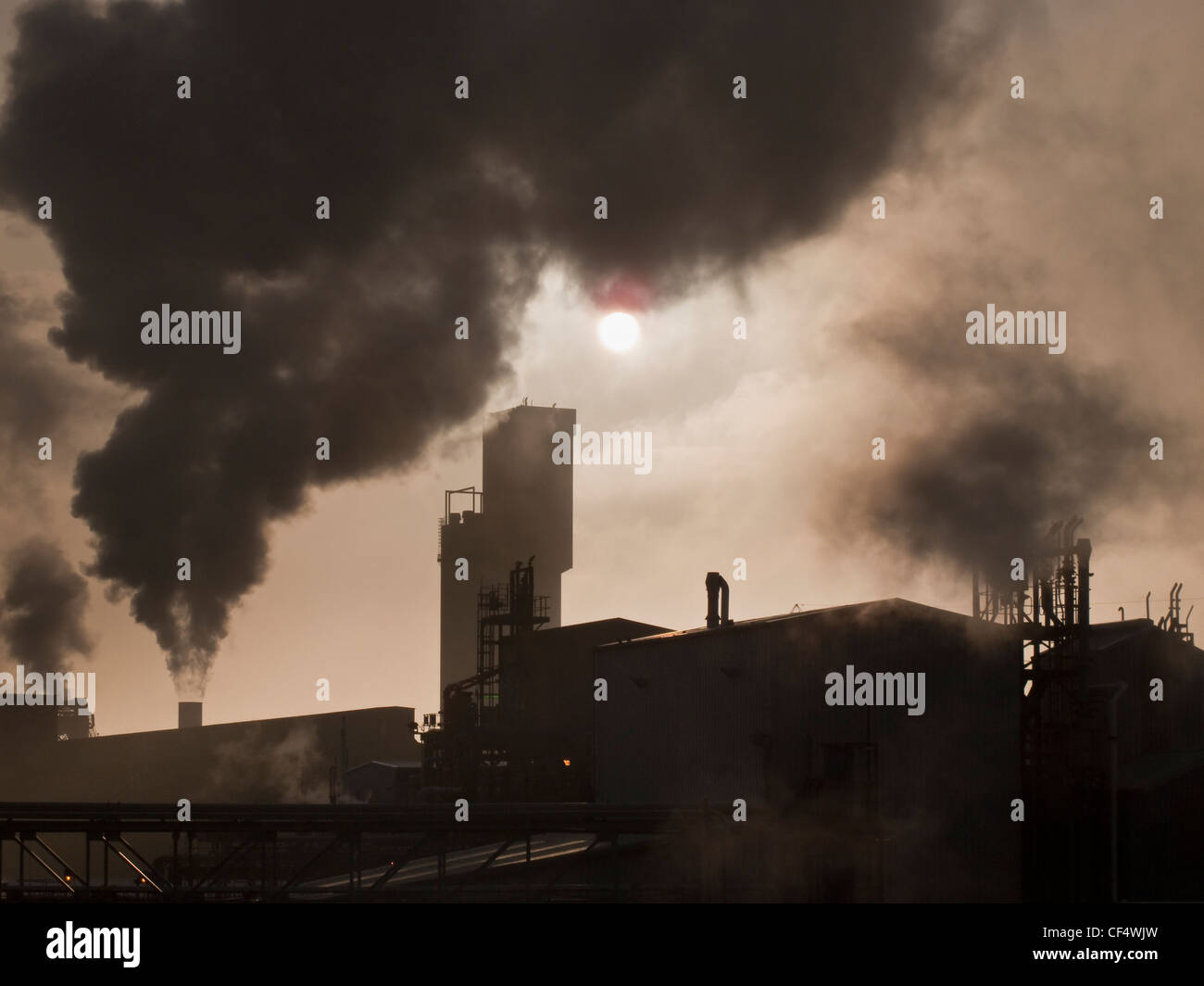 Smoke billowing out from chimneys at the Billingham chemical complex. - Stock Image
