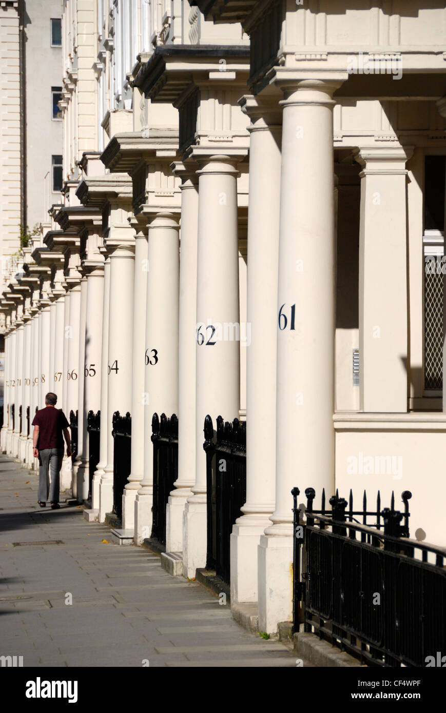 Numbered stone columns outside elegant Victorian terraced houses in Eccleston Square. - Stock Image