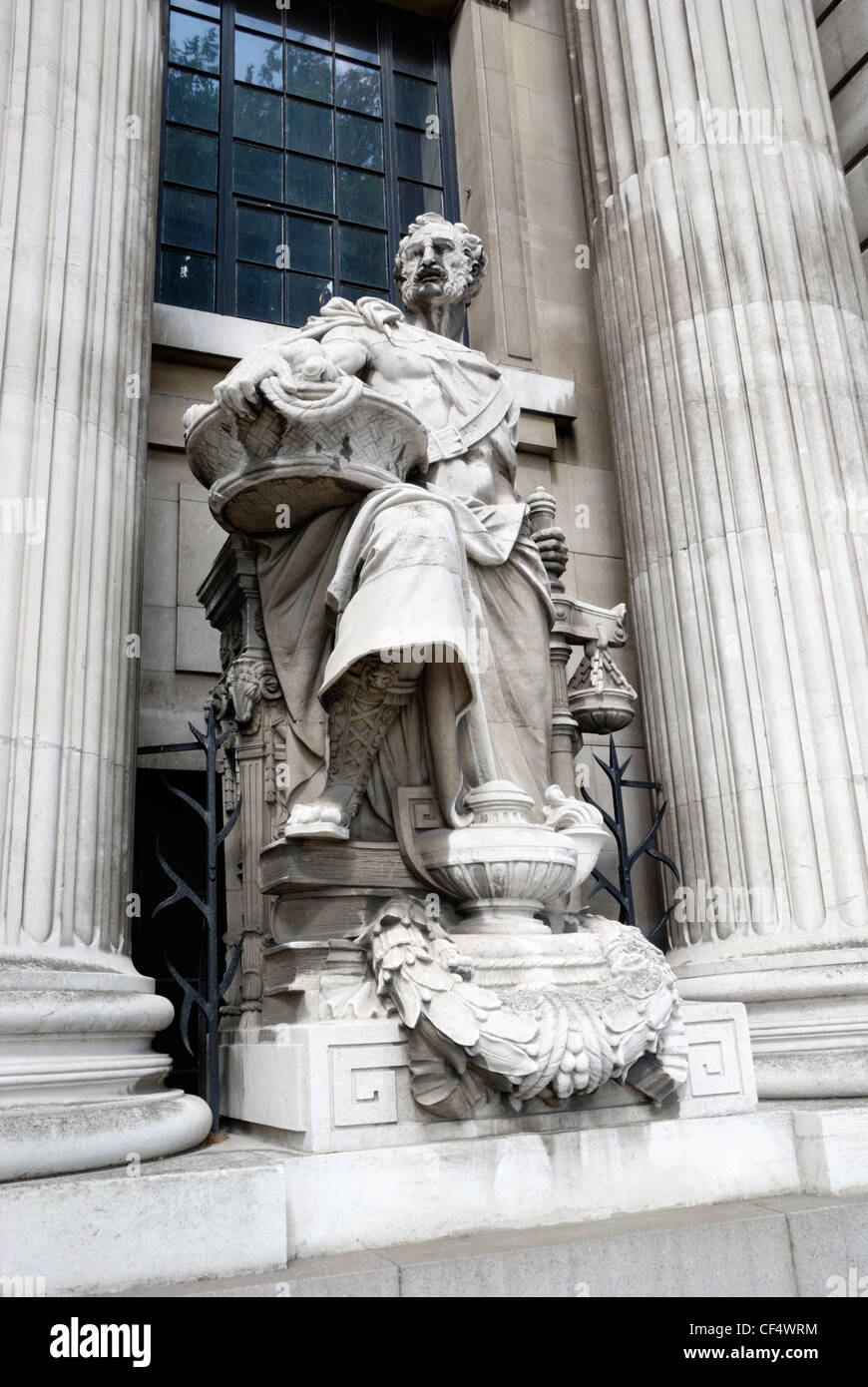 Statue of a merchant on the exterior of the old Port of London Authority Building at 10 Trinity Square. - Stock Image