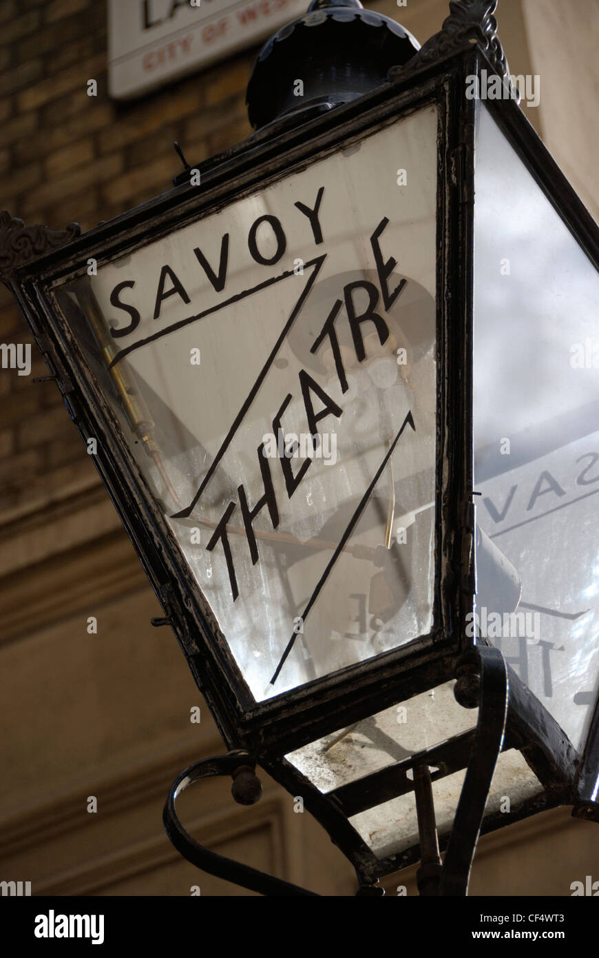 An old streetlamp outside the Savoy Theatre in the Strand. - Stock Image